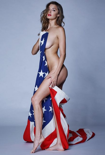 Playboy Playmate Alyssa Arcè shows her patriotic spirit with the United States flag, photo courtesy of Cavan Clark